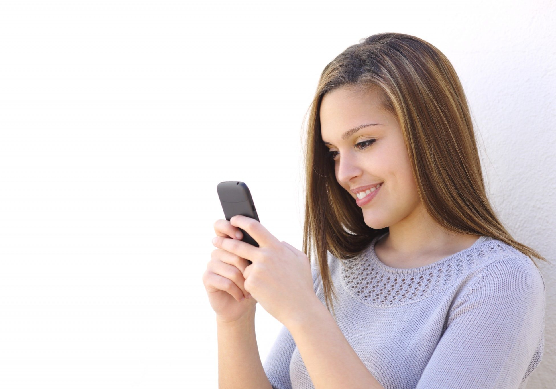 bigstock-happy-woman-texting-on-a-smart-61619678